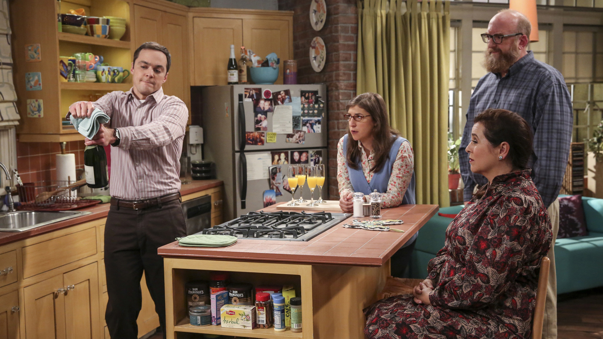 Sheldon struggles to open a bottle of champagne.