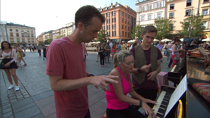 In Detour B, Denise and James Earl (#TeamAlabama) play the piano in Krakow's Old Town Square