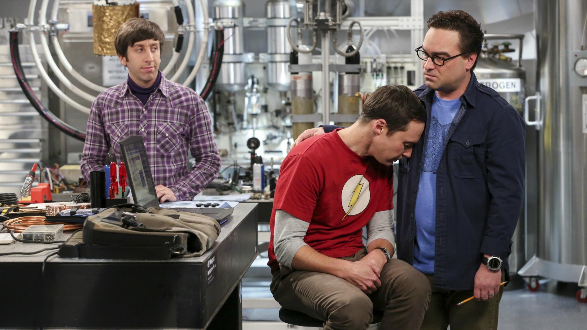 Leonard consoles a sleepy Sheldon.
