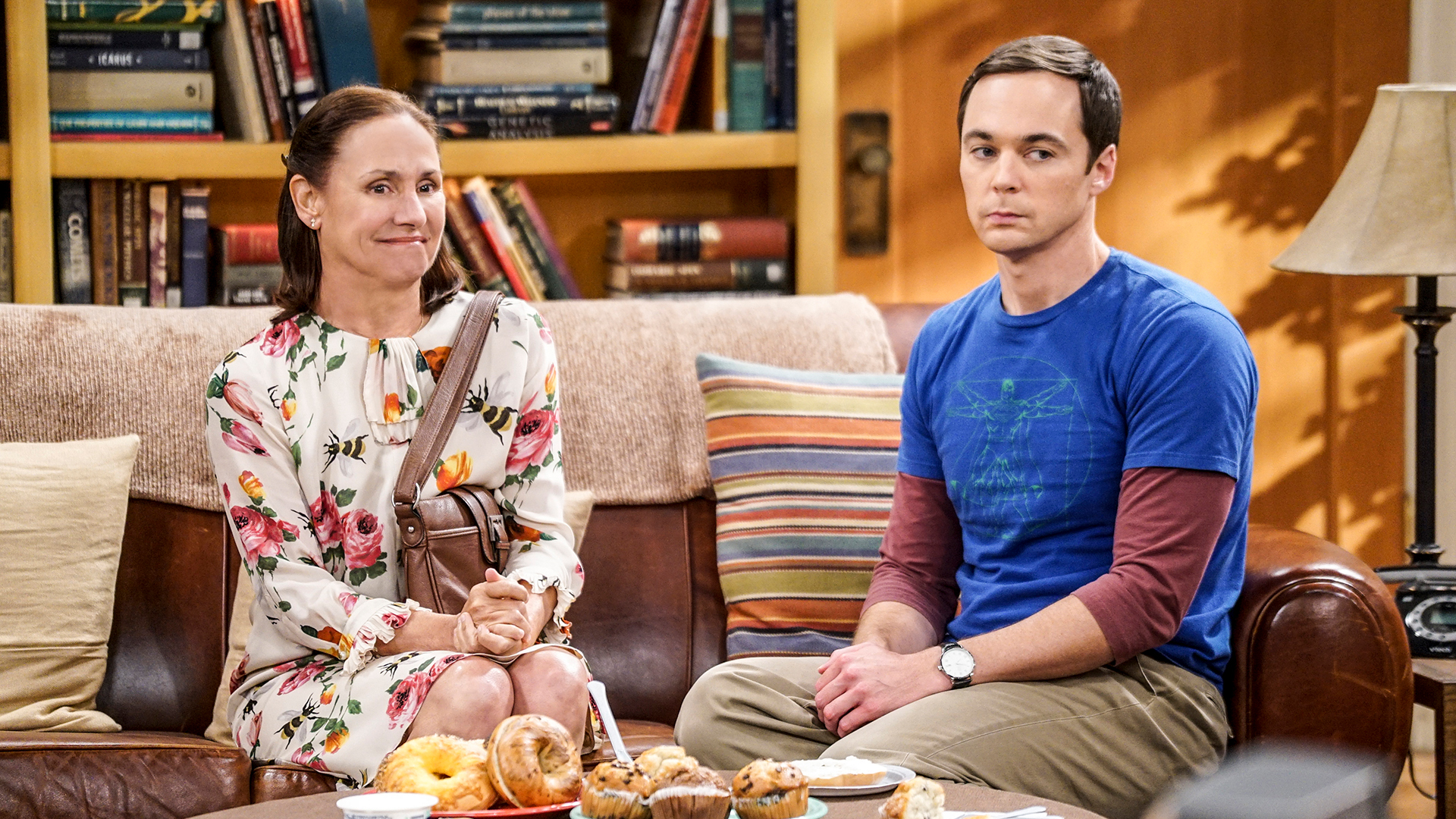 Sheldon's mother, Mary (Laurie Metcalf), sits next to her son on the couch.