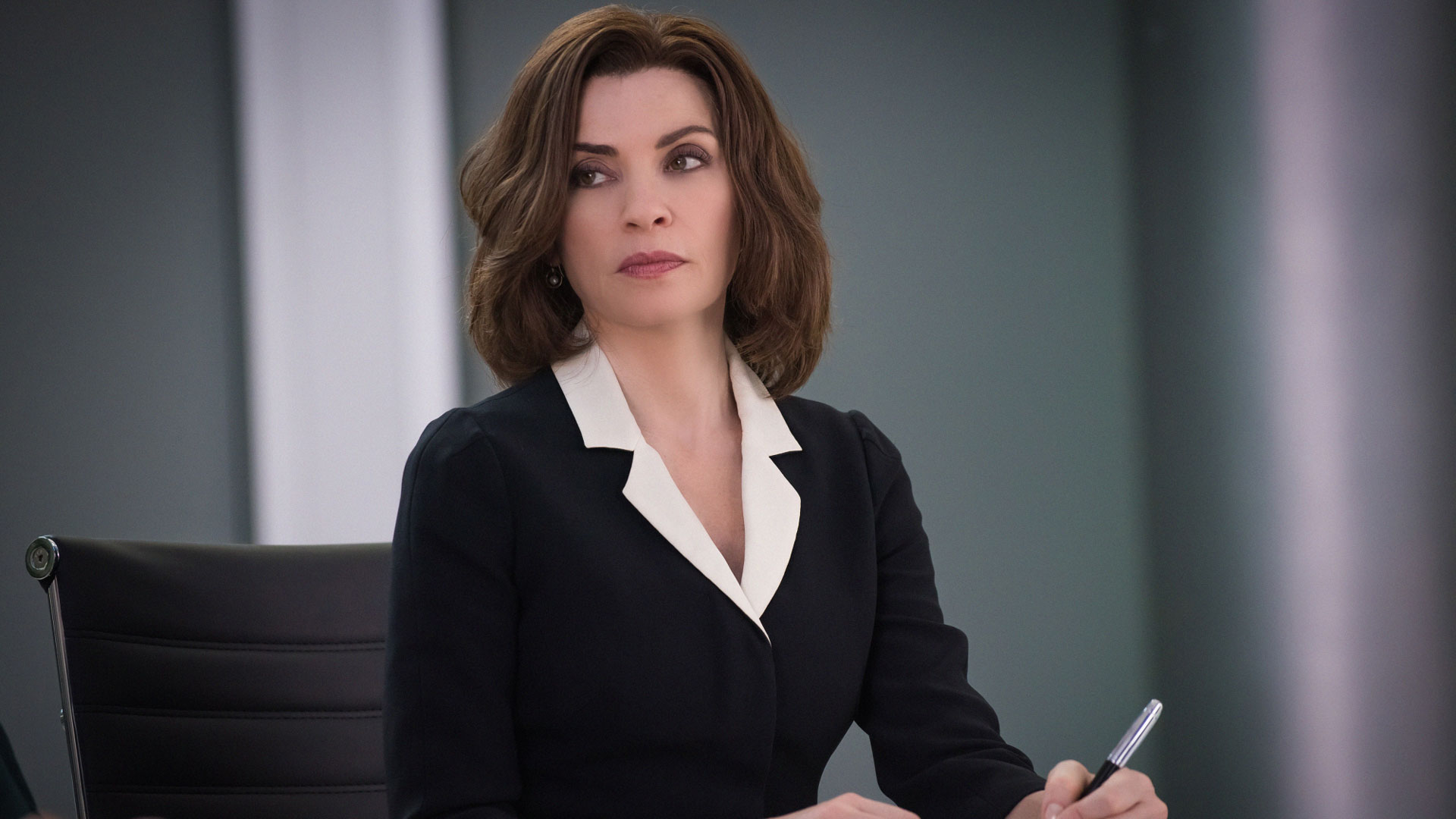 Alicia Florrick takes notes on the case.
