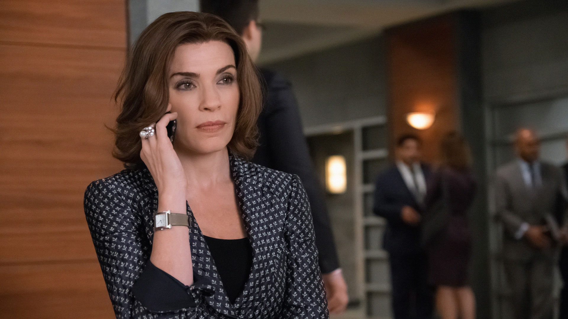 Alicia Florrick receives a call outside of court.
