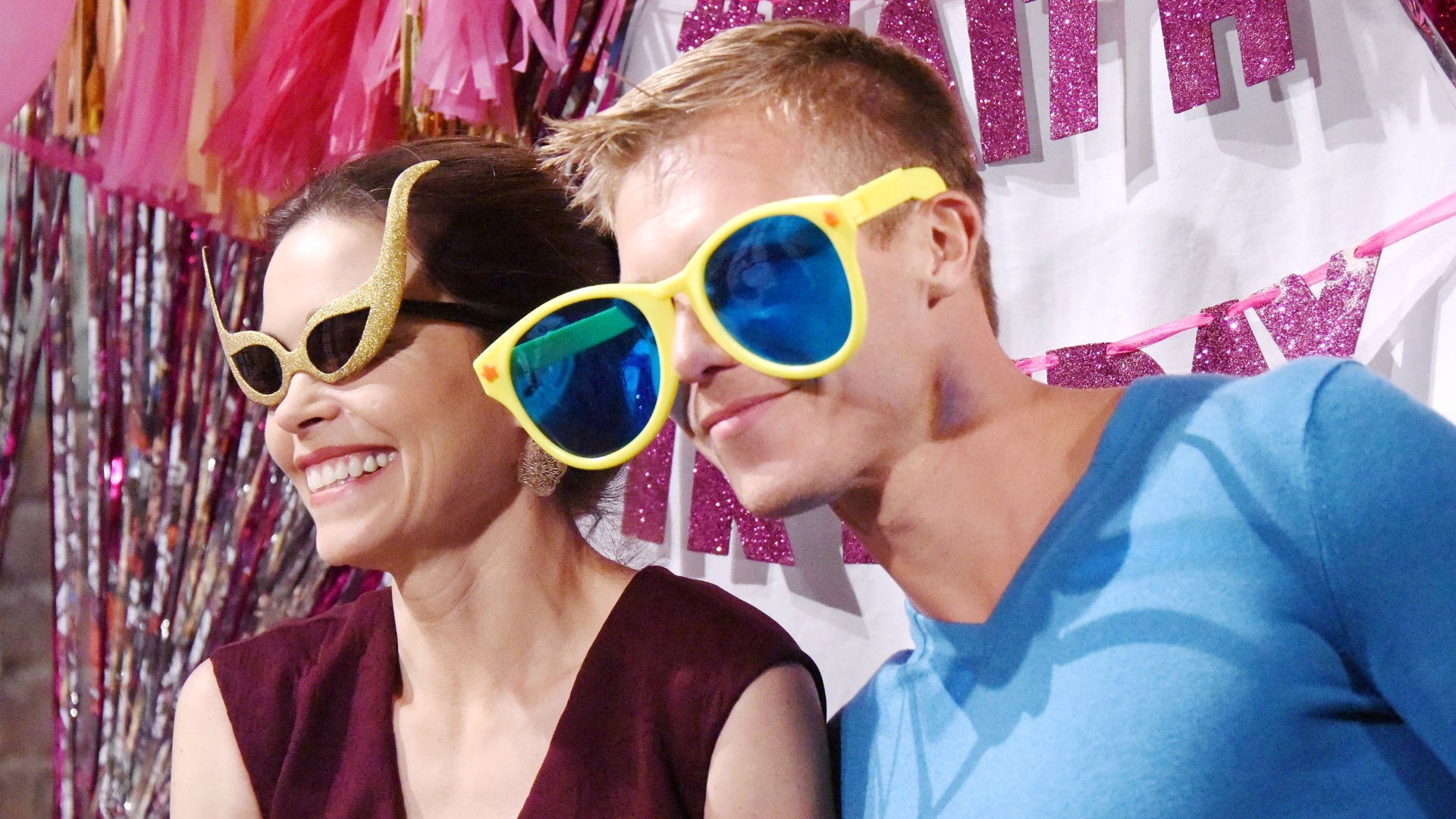 Victoria (Amelia Heinle) and Travis (Michael Roark) goofed around in wacky sunglasses.