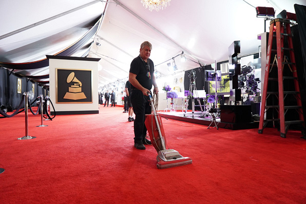 Every inch of the red carpet is perfected before the celebs begin arriving.