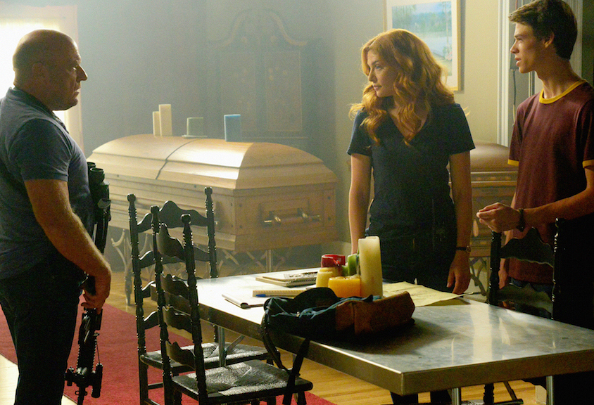 "Dean Norris as James ""Big Jim"" Rennie, Rachelle Lefevre as Julia Shumway, and Colin Ford as Joe McAlister."