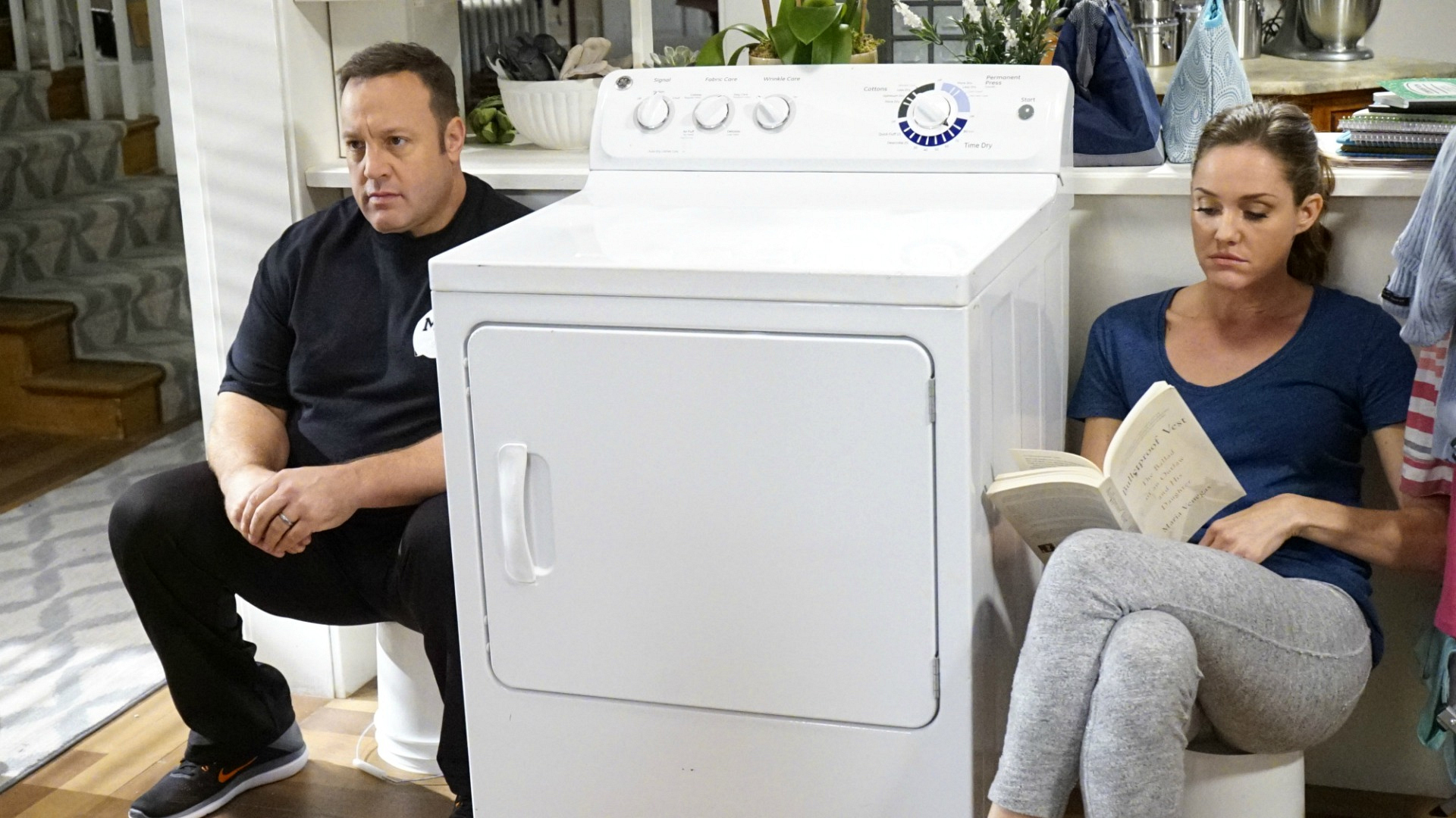 Kevin joins Donna by the dryer for some quiet time.