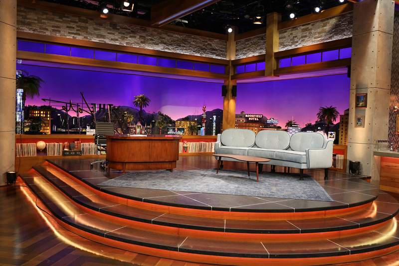 A 3-D Los Angeles skyline sits behind Corden's stage.