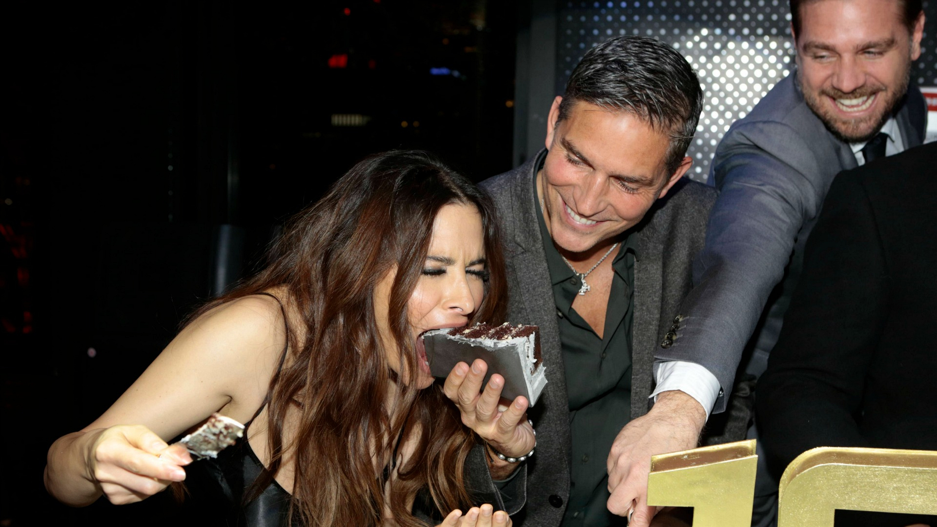 Jim Caviezel fed Sarah Shahi a huge slice of cake.