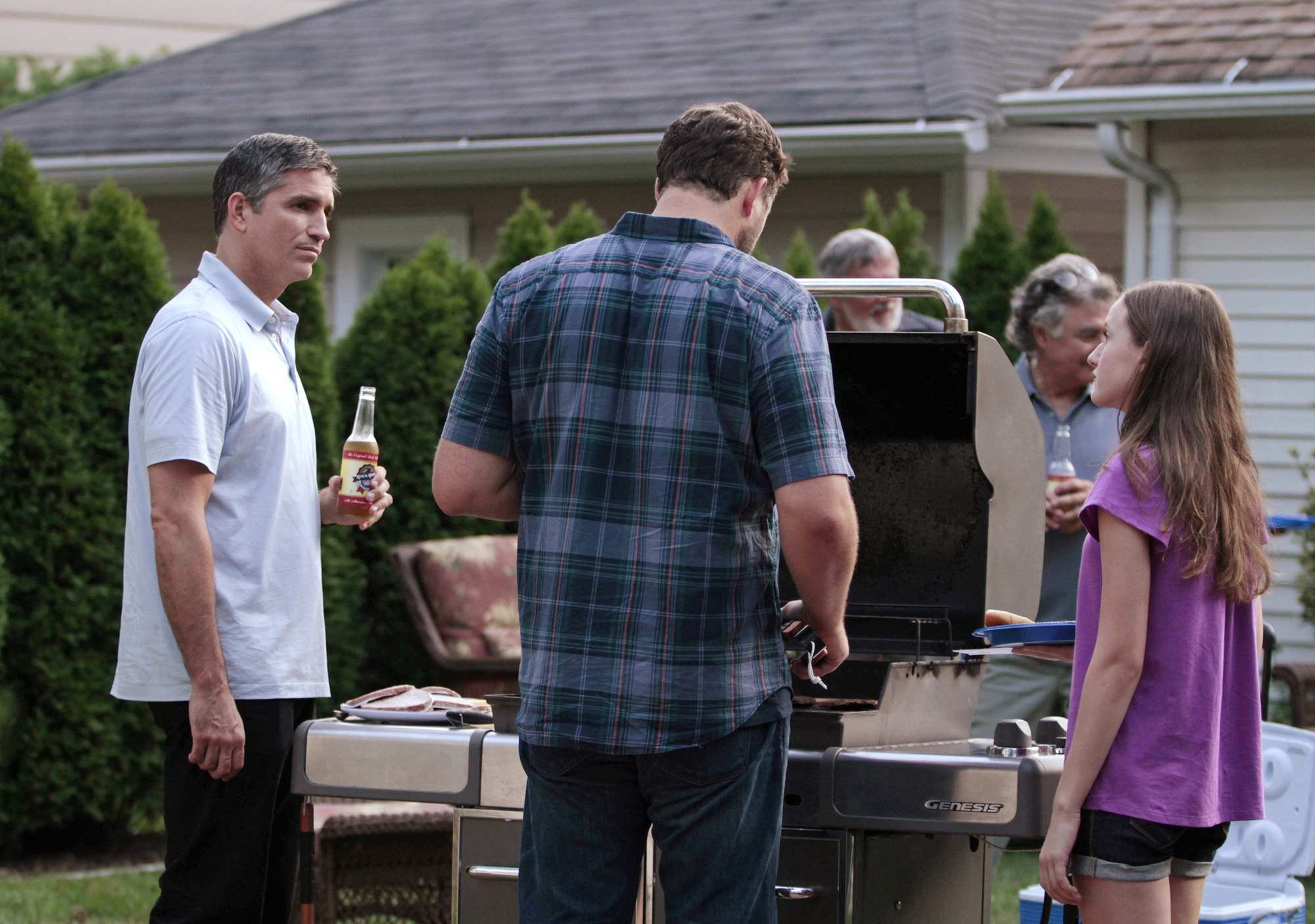 Reese Has a Beer by the Grill
