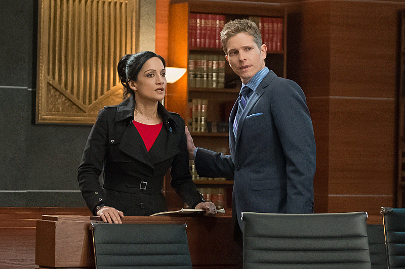 Kalinda comes to Cary's side.
