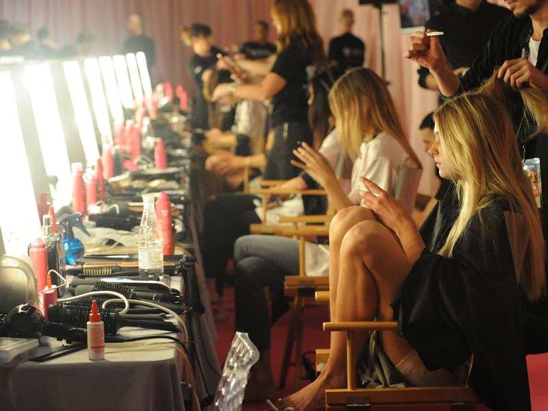 Getting primped before they take the catwalk.
