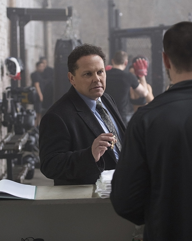 Fusco shows flashes his gold.