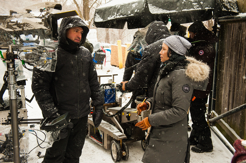 Lucy Liu discusses an exterior scene with camera and Steadicam operator, Alan Mehlbrech