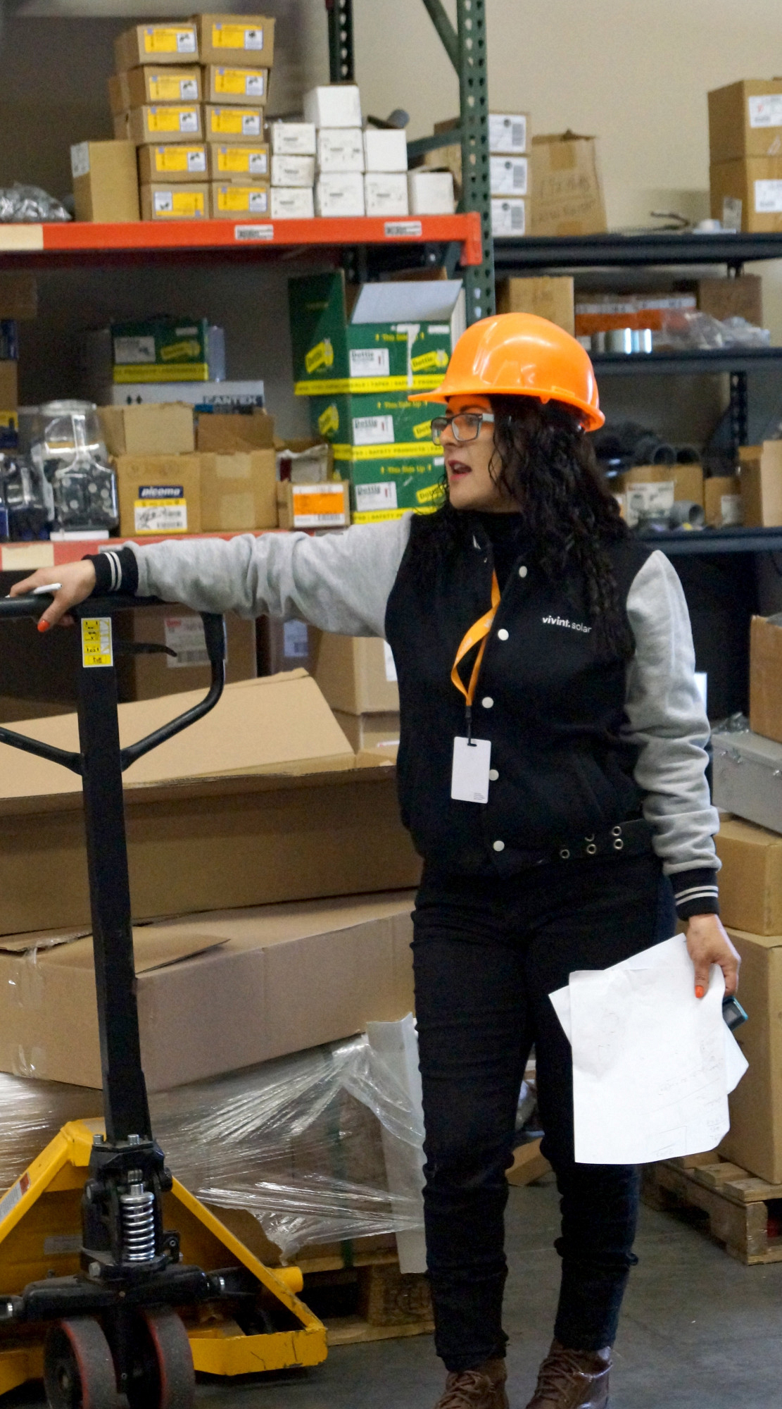Working in the warehouse with an employee