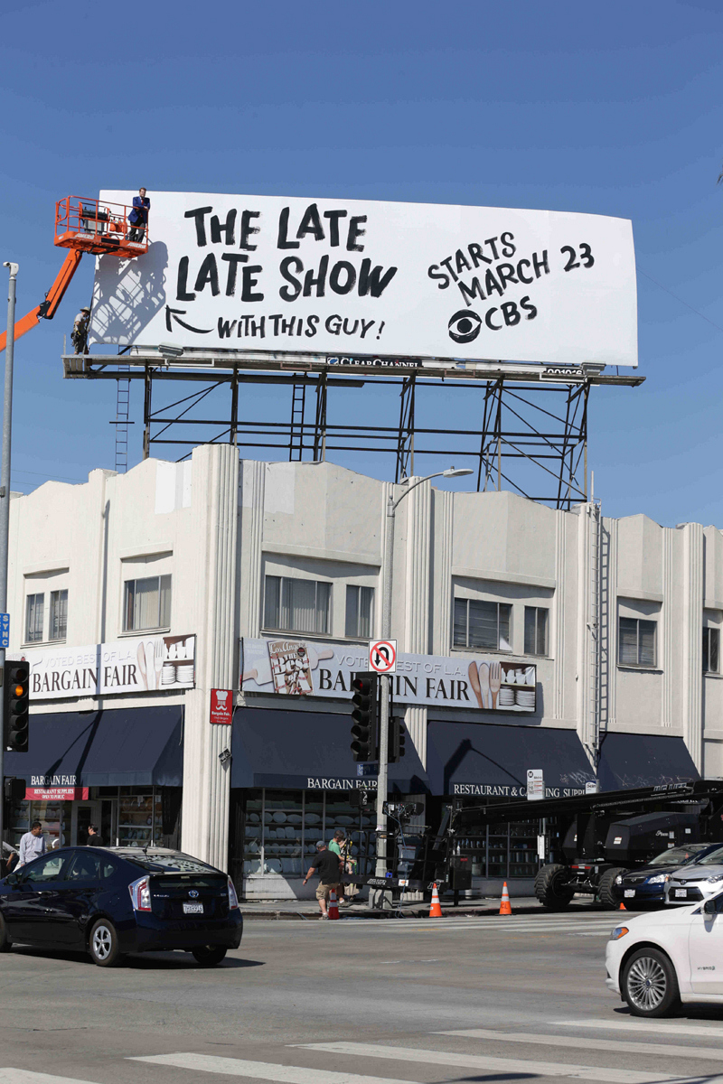 Corden becomes part of his own billboard.