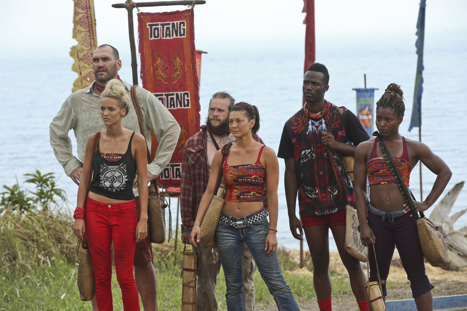 The six members of the Brawn Tribe give host Jeff Probst their full attention.