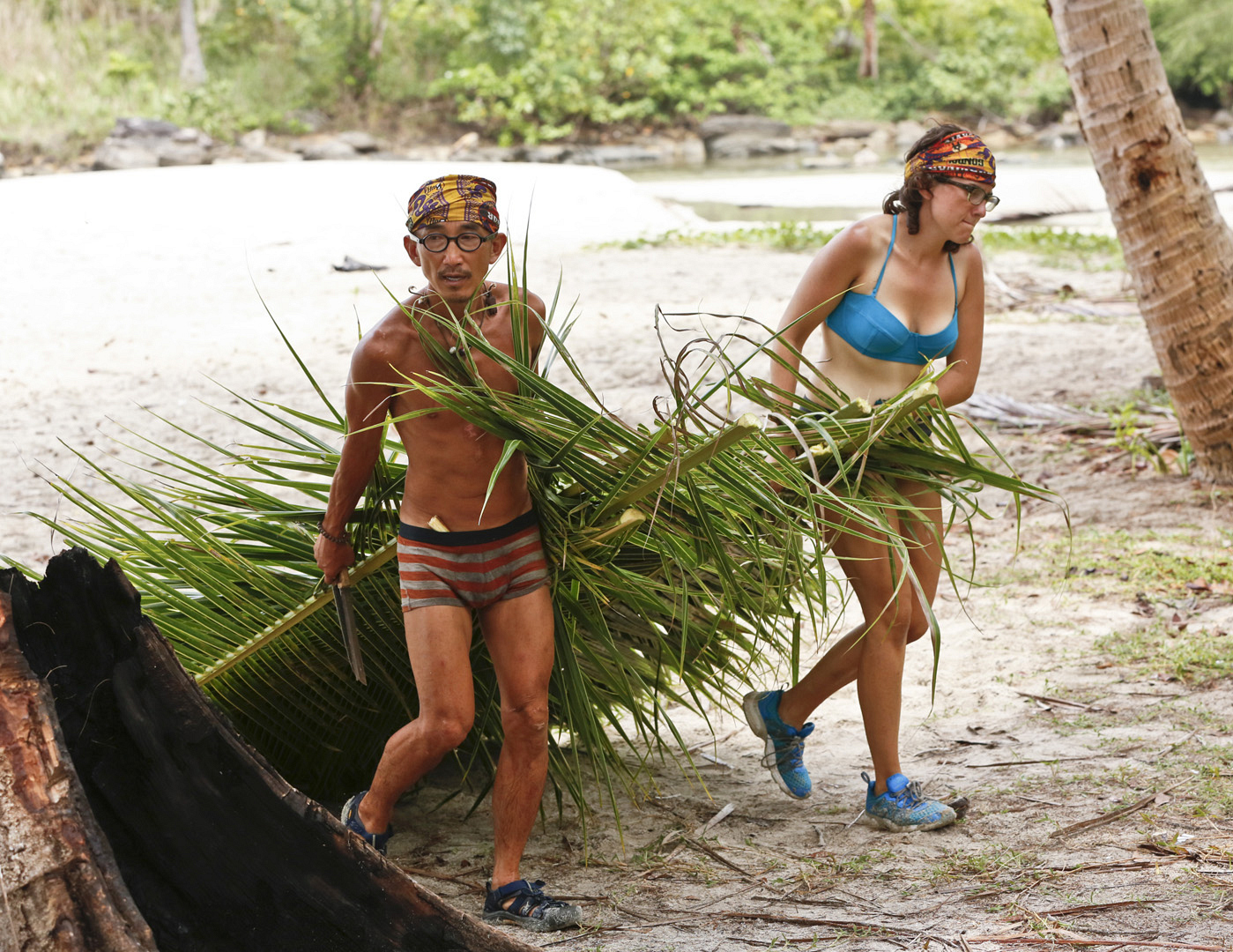 Tai and Aubry work together around camp.