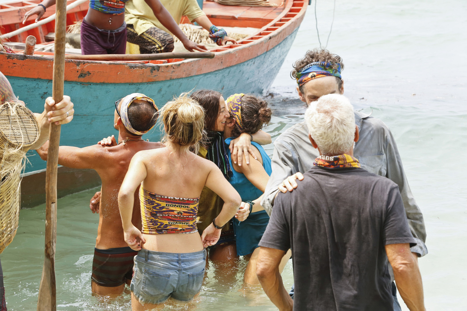 All the castaways exchange hugs and kisses at the merge.