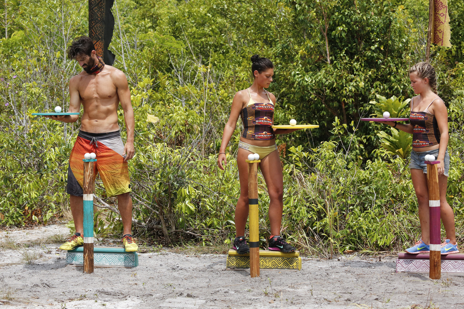 Nick, Michele, and Julia try to keep their balance in the next challenge.