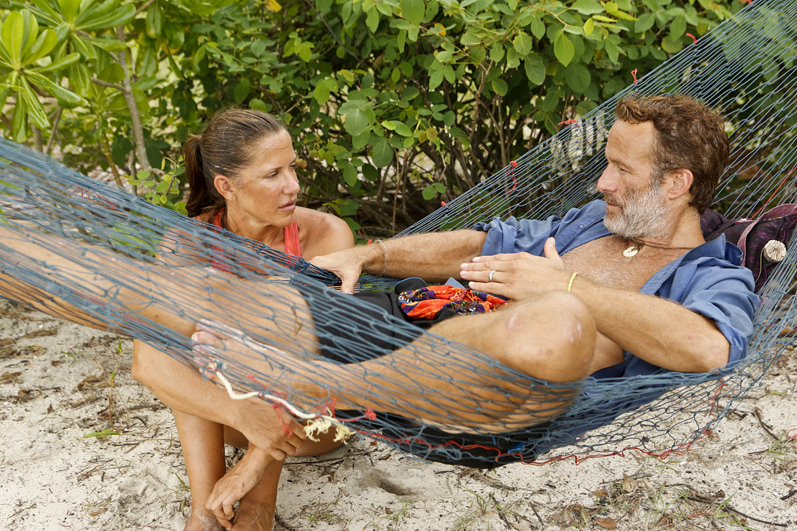 Kelly Wiglesworth talks to Andrew Savage while he lays back in a hammock.