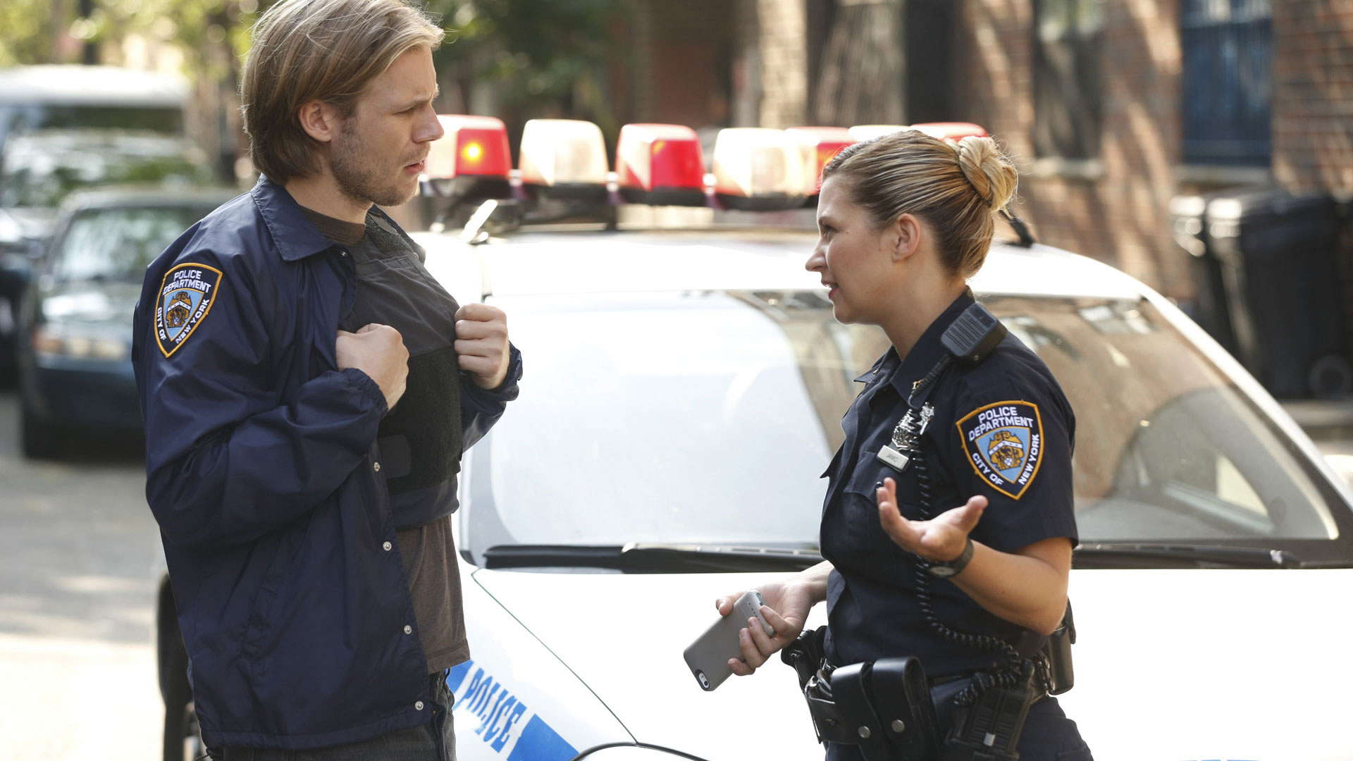 Zachary Booth as Lorenzo Colt and Vanessa Ray as Officer Edit Jenko