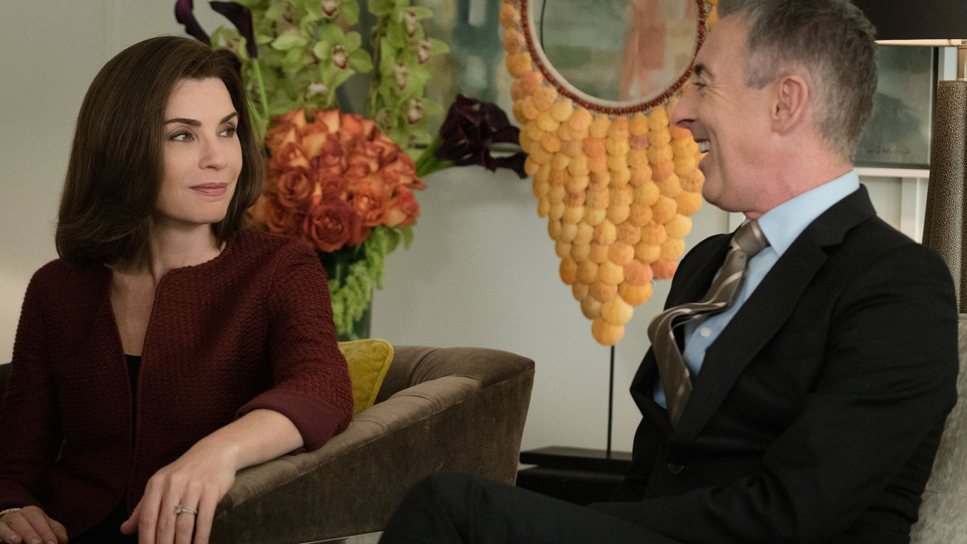 Julianna Margulies as Alicia Florrick and Alan Cumming as Eli Gold