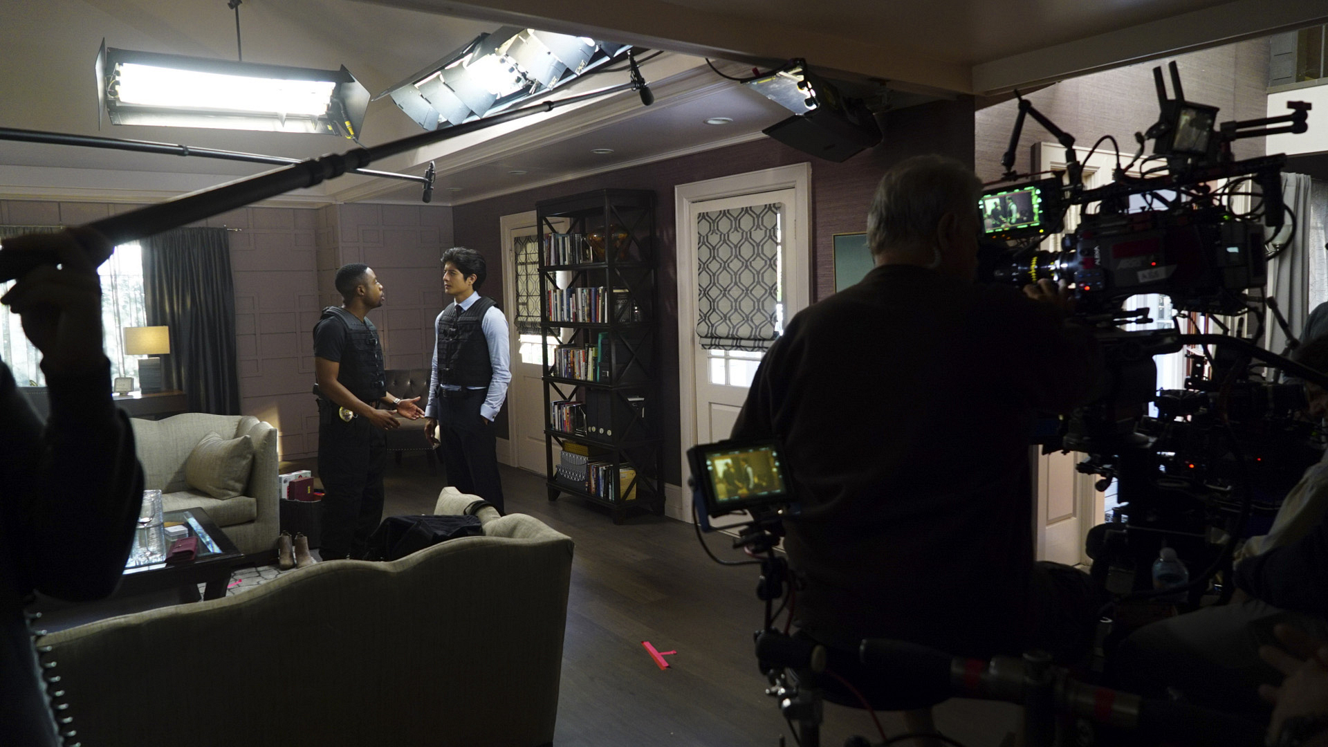 This backstage view shows Justin and Jon acting out a scene together on set.