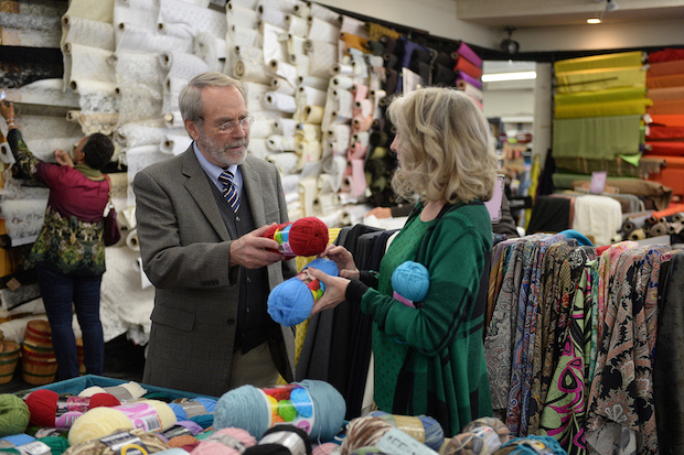 Gary chats with women at the craft store.