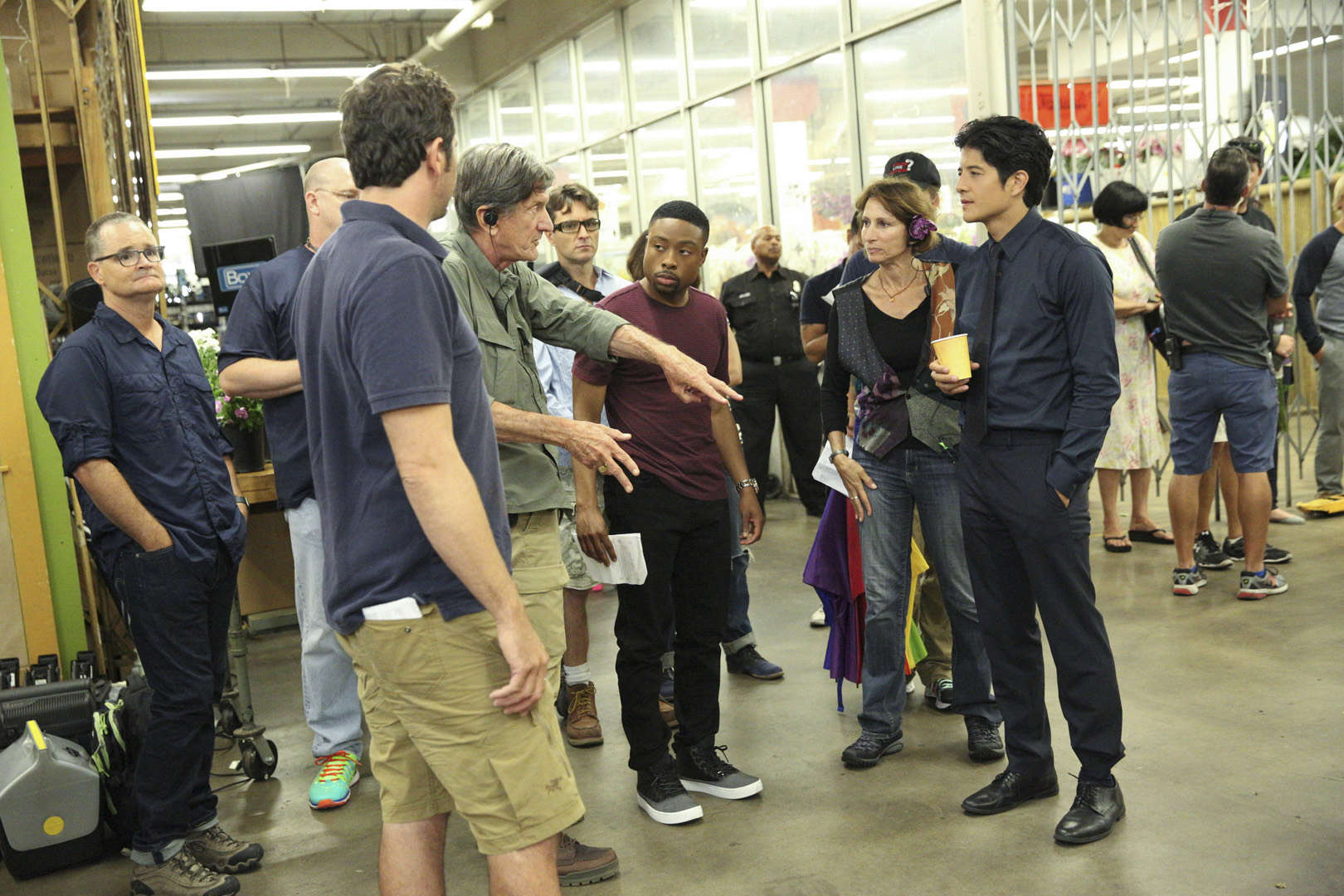 Director John Badham, Justin Hires, and John Foo go over a scene.