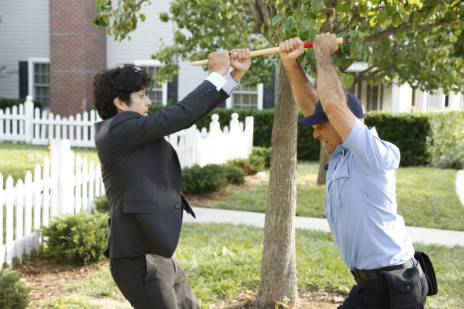Lee tries to take out a man disguised in uniform.