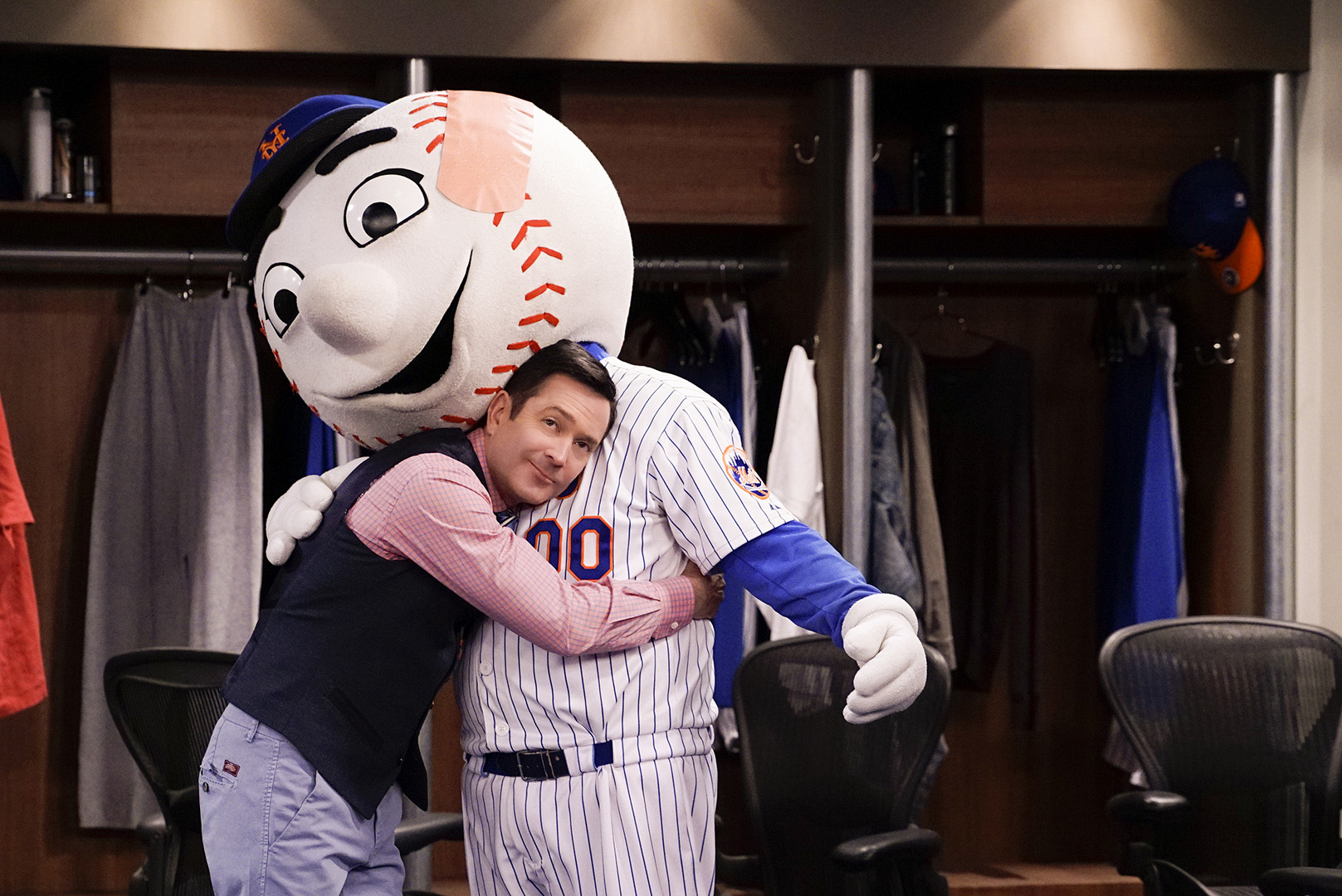 Felix gives Mr. Met a big hug.