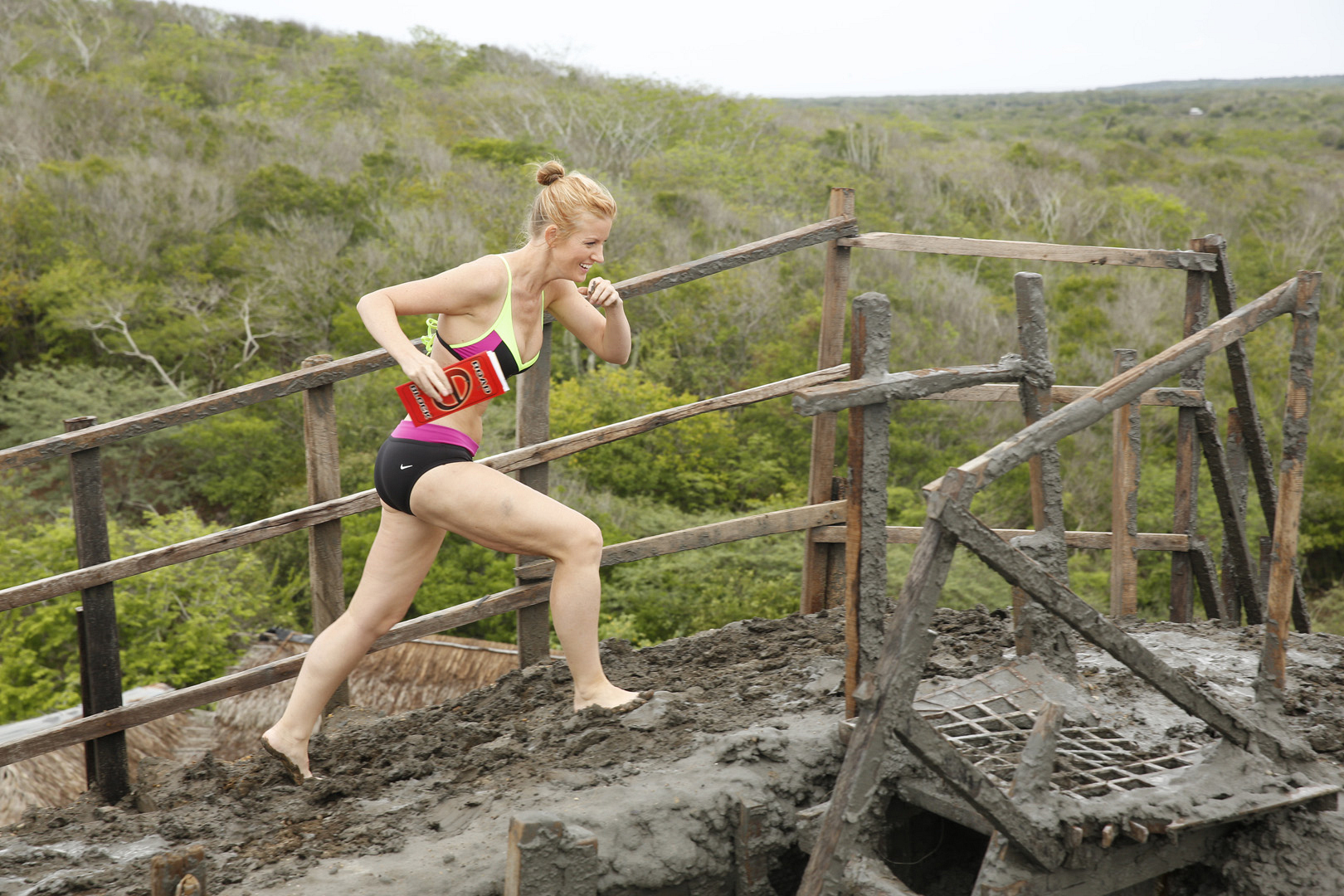 Ashley runs through the slippery mud in search for an emerald.