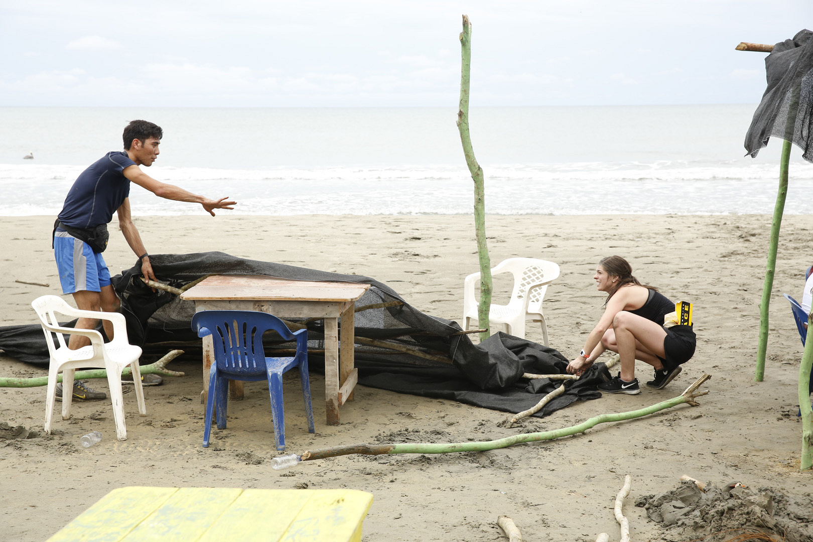 "In ""Pop-Up,"" Zach and Rachel must build a beach shelter using poles, sticks, and tarps."