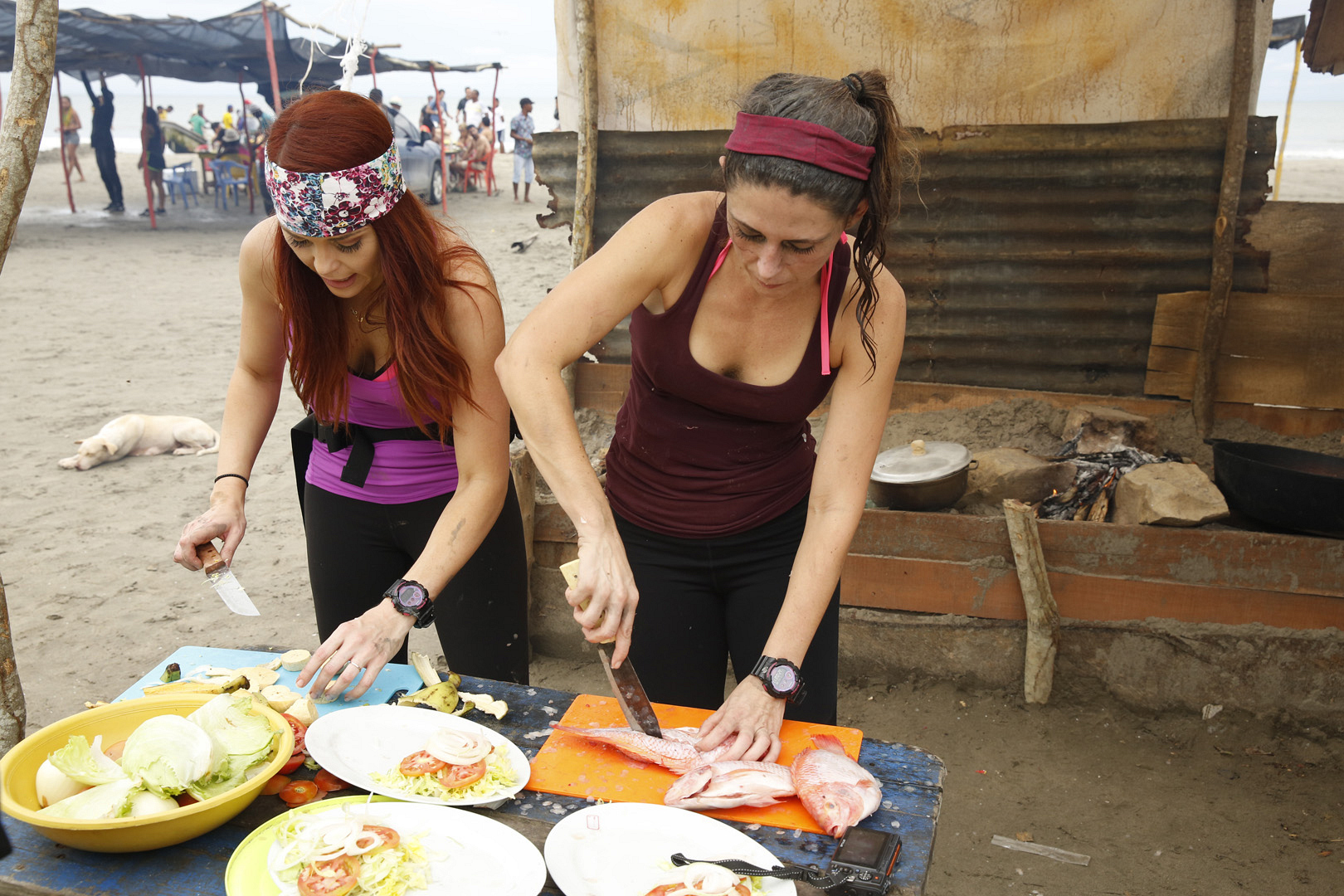 "In ""Parrilla,"" Erin and Joslyn prepare fried fish, plantains, and rice."
