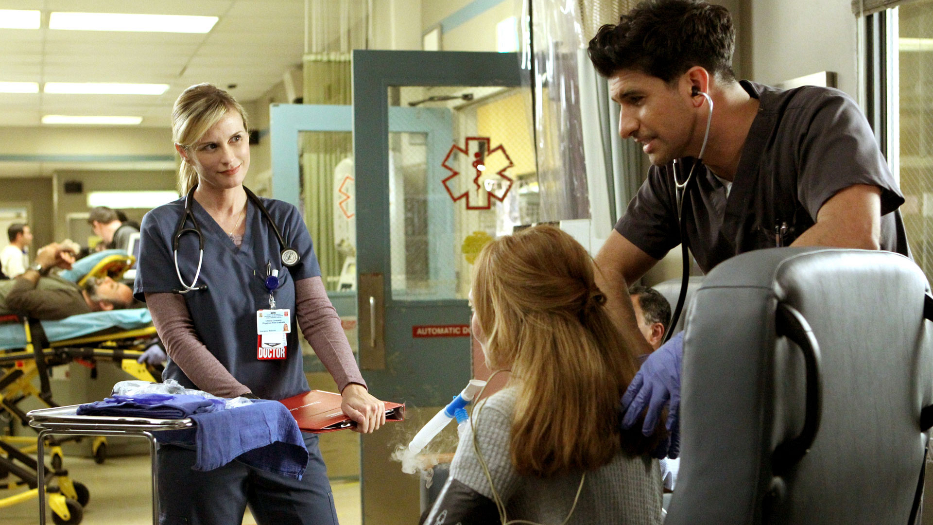 Bonnie Somerville as Dr. Christa Lorenson and Raza Jaffrey as Dr. Neal Hudson