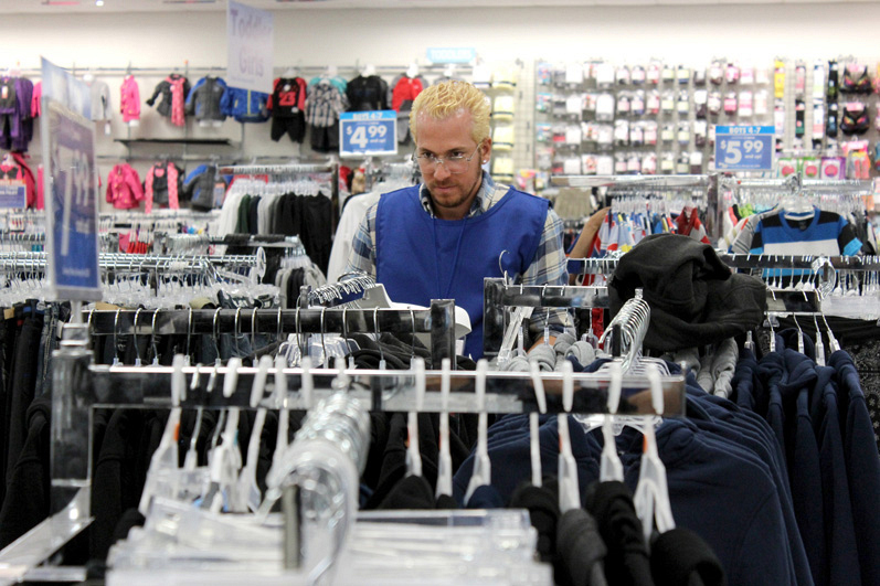Without a whole lot of time to dawdle, Sam inspects some of the store's merchandise.