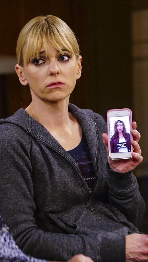 Christy shows Bonnie her mug shot.