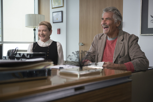 John and Joan share a laugh in Jen's office.
