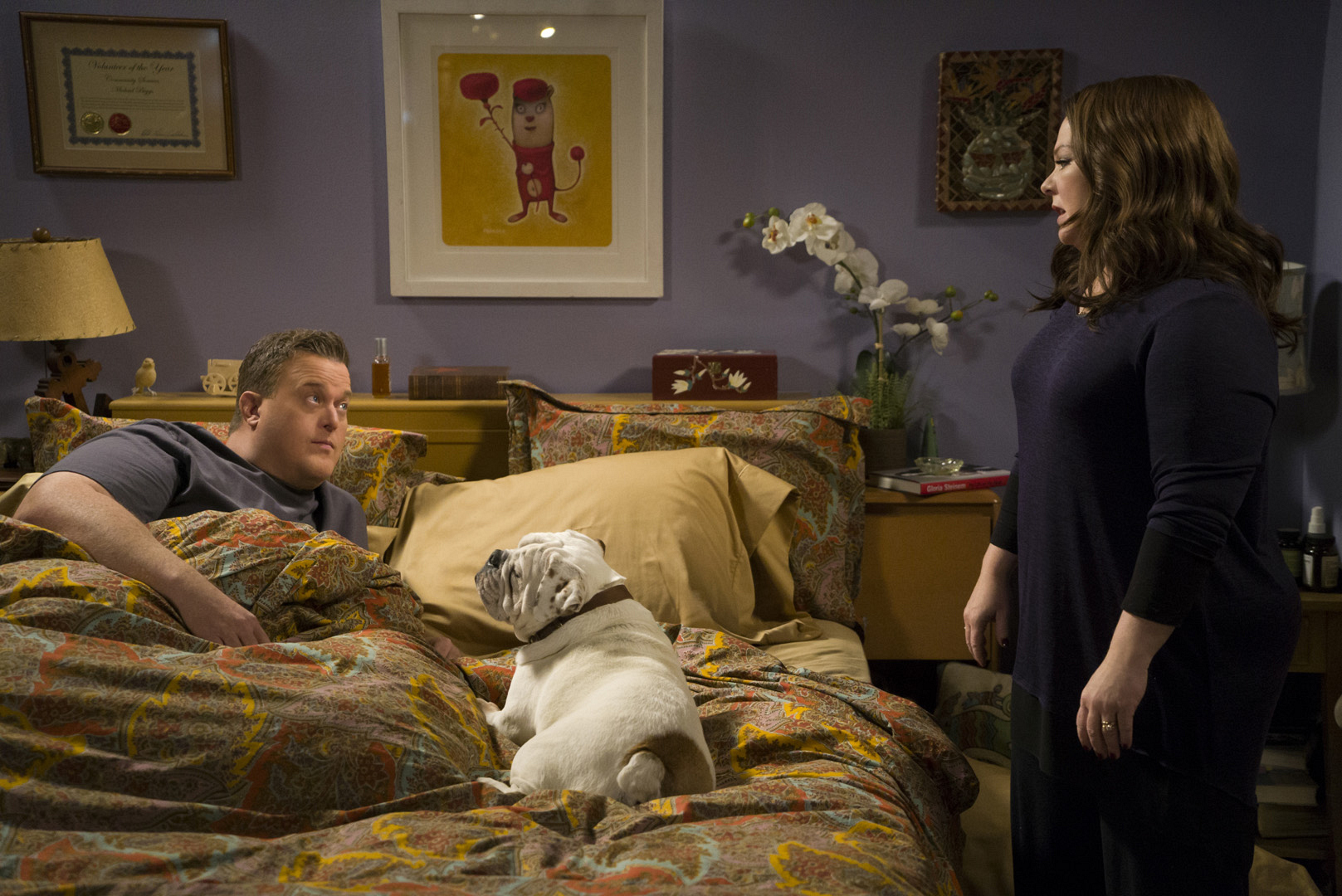 There doesn't seem to be enough room in the bed for Mike, Molly, and Birdie.