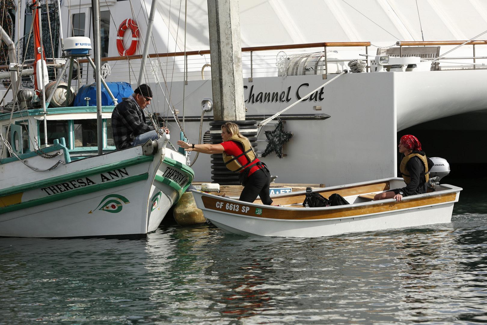 "Sheri and Cole search Santa Barbara Harbor for the ""Theresa Ann"" boat."