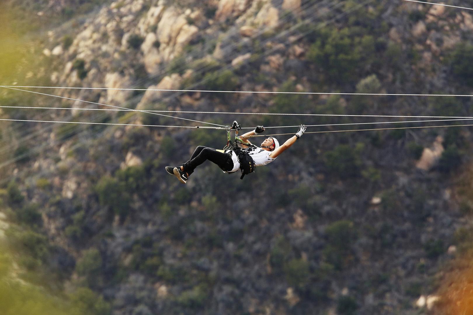 Matt hangs in midair from her zip line.