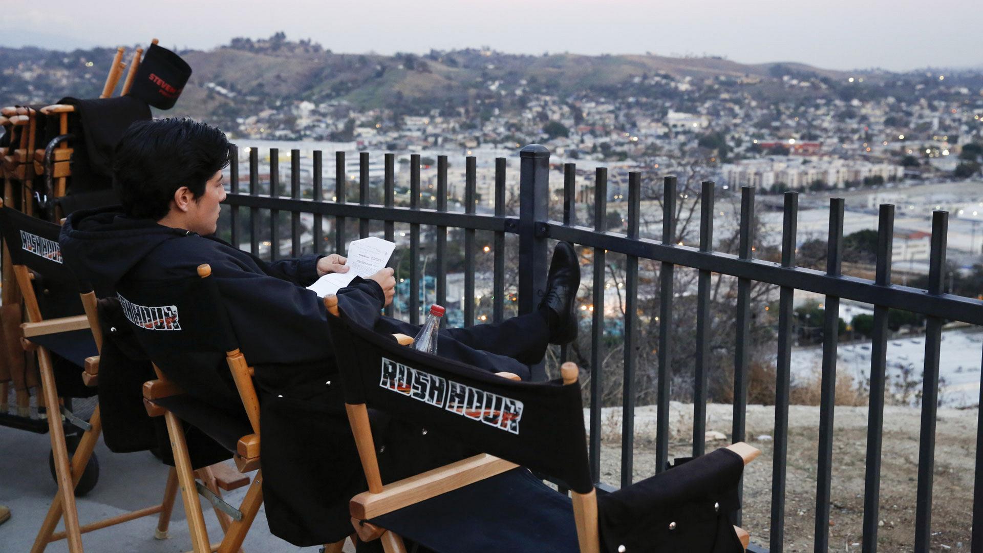 Jon Foo looks over the script.