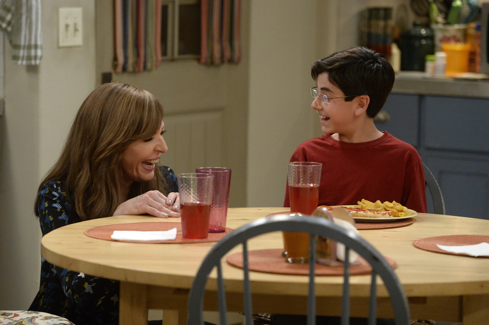 """Allison Janney and Blake Garrett Rosenthal share a laugh while filming the episode """"Nazi Zombies And A Two-Hundred Pound Baby."""""""