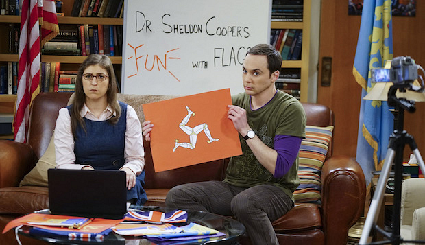 Amy is confused by Sheldon's intriguing flag.