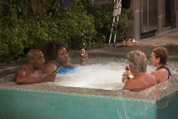 Joan and John spend quality hot-tub time with their neighbors.