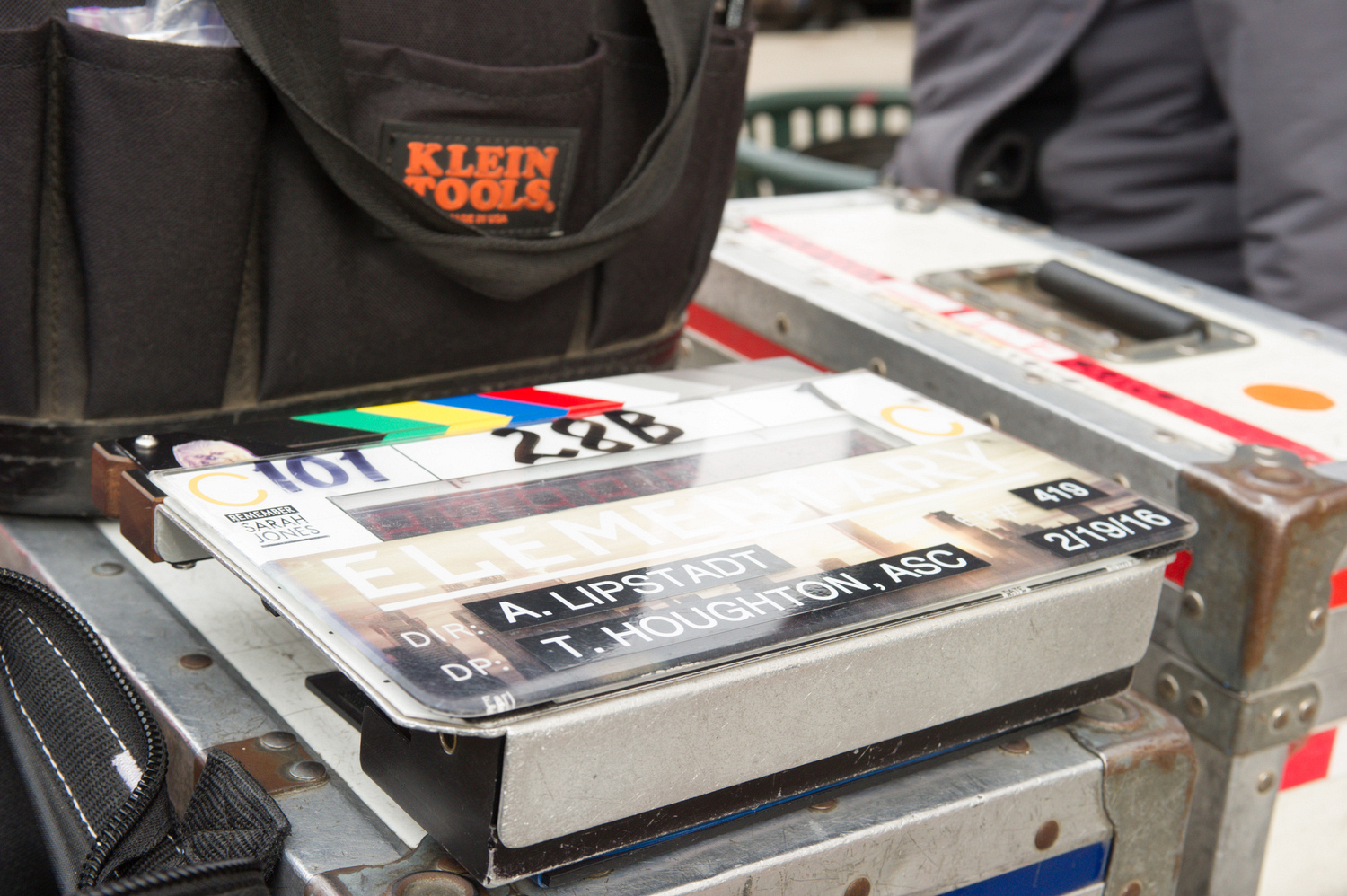 A clapboard listing the episode's director and director of photography