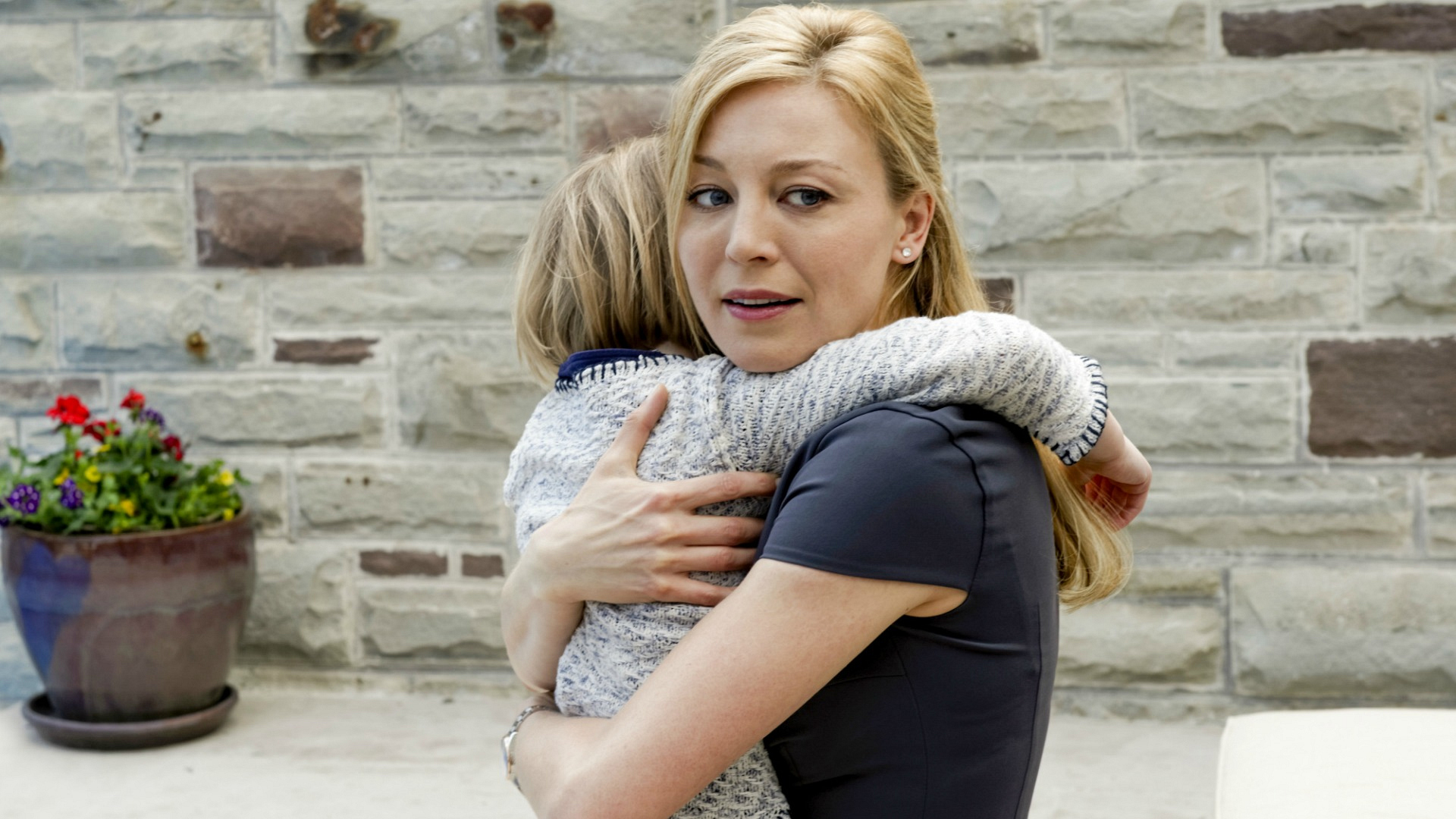 Alison hugs her daughter.