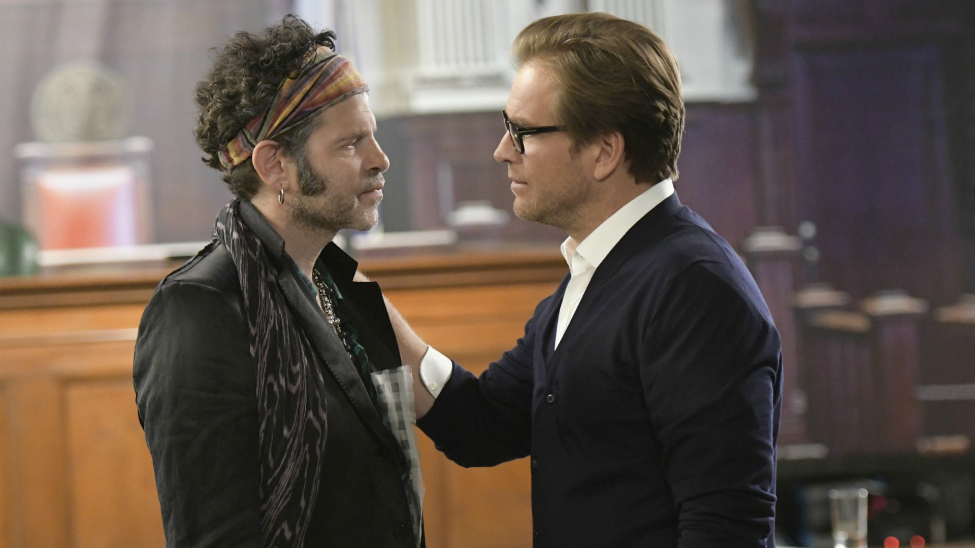 Dr. Bull preps a client before sending him in front of another mirror jury.