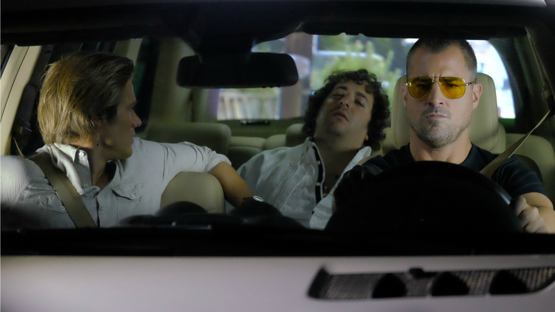 Jack takes the wheel while Mac checks on the man in the backseat.