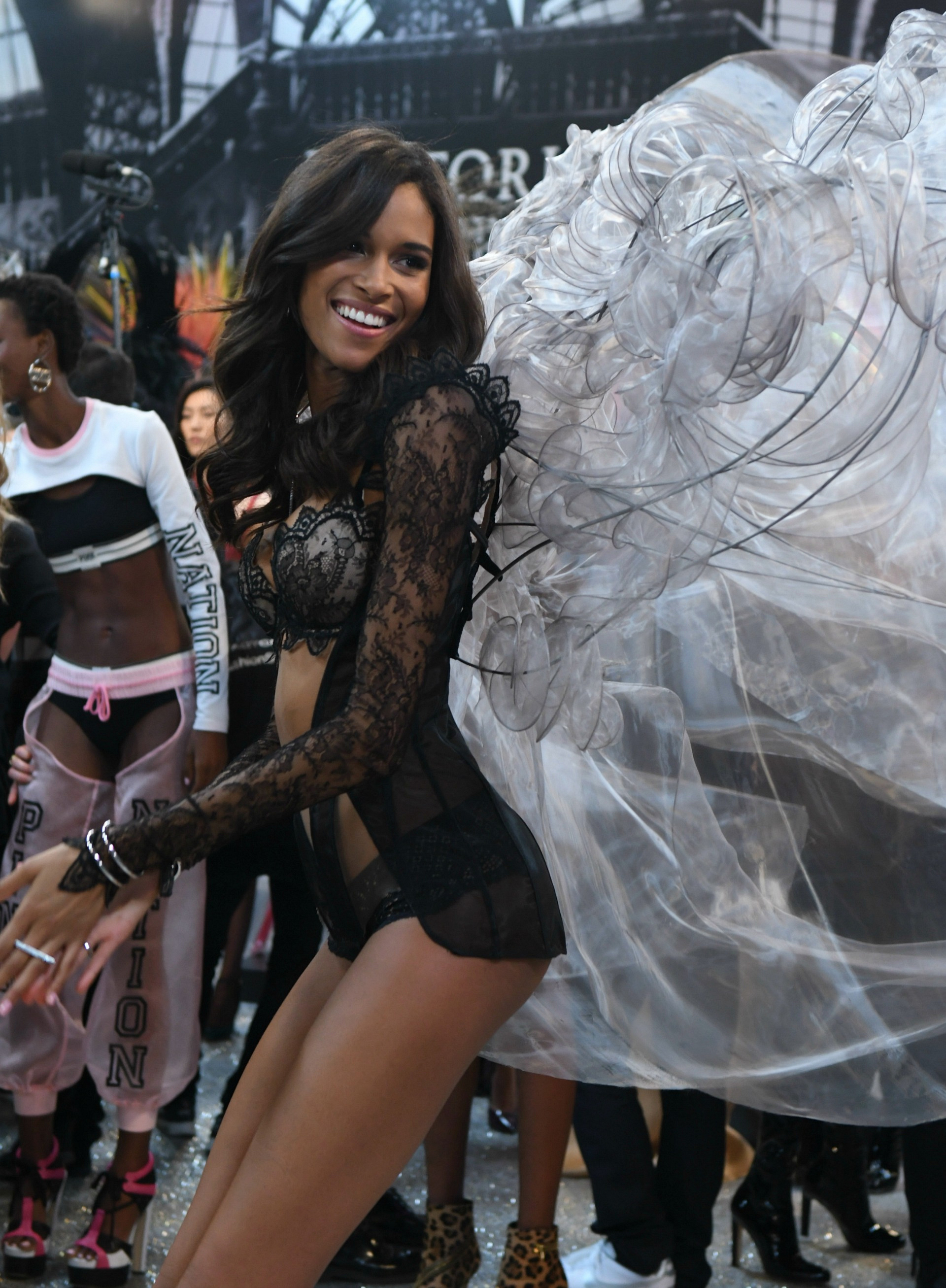 Cindy Bruna shakes her tail feathers backstage.